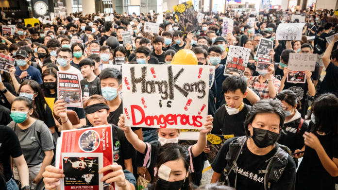 Hong Kong airport protests escalate with canceled flights and police standoffs